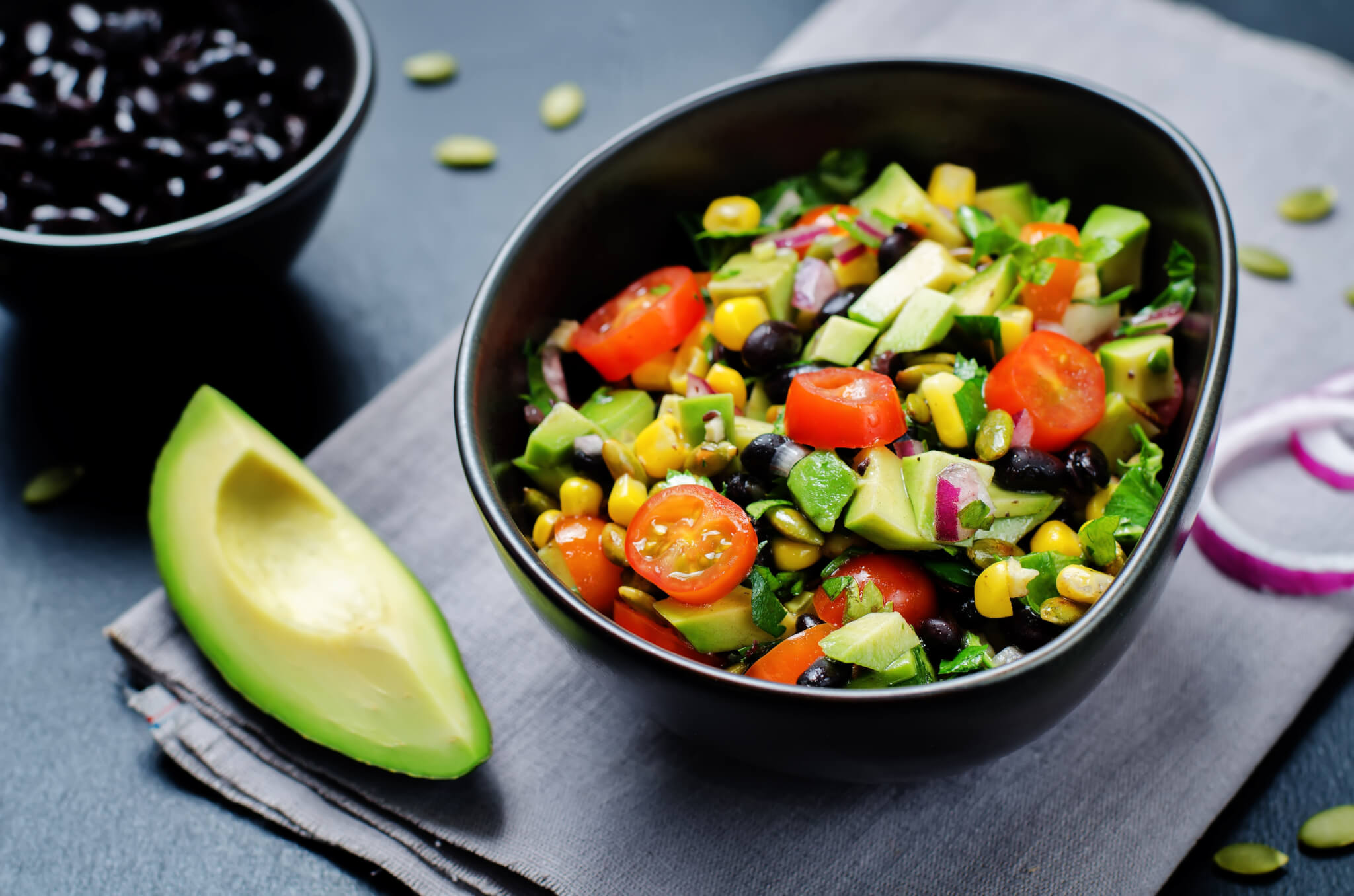 Black beans corn avocado red onion tomato salad with lime dressing